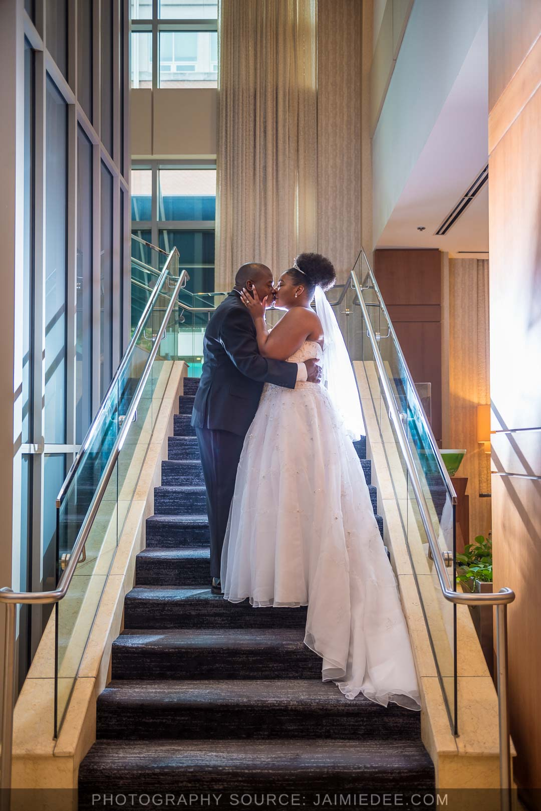 Georgia Tech Hotel and Conference Center bride and groom on staircase in lobby area