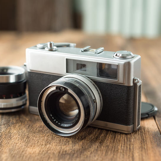 Old retro Film camera on wooden background